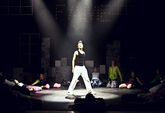 spotlight on a person on a stage